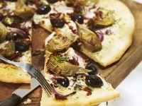 Pizza mit Artischockenherzen Rezept