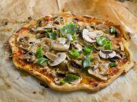 Pizza mit Champignons Rezept