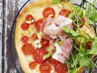 Pizza mit Parmaschinken Rezept