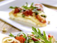 Pizza mit Rucola und Zucchini Rezept