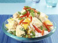 Reis-Paprika-Salat mit Mango und gekochtem Curryhähnchen Rezept