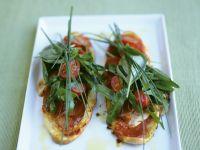 Röstbrot mit Pancetta, Tomaten und Kräutern