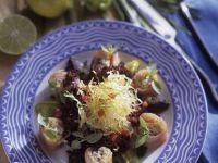 Salat mit Fischröllchen