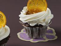 Schoko-Cupcake mit Sahne und Orangenscheibe Rezept
