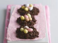 Schokoladennester mit bunten Zuckereiern Rezept