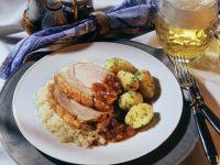 Schweinebraten mit Sauerkraut und Kartoffeln Rezept