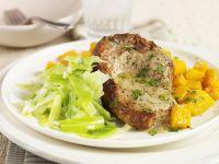 Schweinekarree mit Kräuterbutter und Gemüse Rezept
