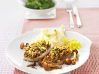Schweineschnitzel mit Pilzhaube und Kartoffelbrei Rezept