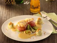 Seeteufel-Medaillons mit Bratapfelsauce, Lauchgemüse und Grießbällchen