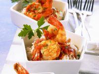 Shrimps mit Cognac-Tomaten-Soße und Reis Rezept