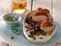Spanferkelbraten auf schwarzem Linsengemüse mit Zitronenthymian-Pesto Rezept