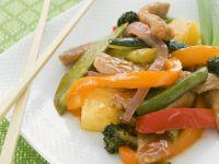 Süß-saures Schweinefleisch mit Gemüse und Reis Rezept