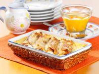 Überbackene Pfannkuchenrollen mit Quarkfüllung und Aprikosensauce Rezept