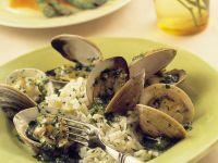 Venusmuscheln mit Reis Rezept