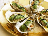 Weihnachtliche Austern mit Kräuterkurste und Pilzen Rezept