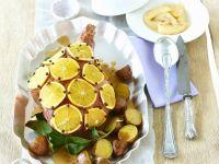 Weihnachtliche Spanferkelkeule mit Orangen und Nelken Rezept