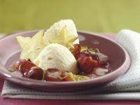 Weiße Mousse au Chocolat mit roten Trauben Rezept