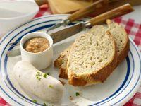 Weißwürste mit Brot und Senf Rezept
