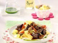 Wildschweinragout mit Morcheln und Estragon-Orangenöl Rezept