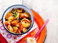 Würstchen mit Tomaten, Zwiebeln und Safran Rezept
