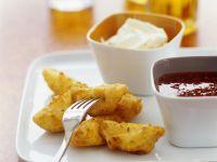 Würzige Kartoffelecken mit Chilisoße und Schmanddip Rezept