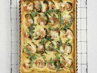 Zucchinikuchen mit Garnelen und Rucola Rezept