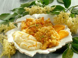 Ausgebackene Hollerküchle mit Orangenschaum Rezept