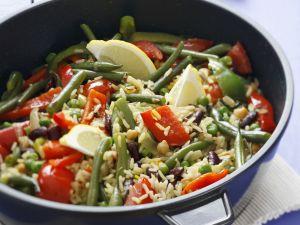 Bunte Reispfanne mit Paprika und grünen Bohnen Rezept