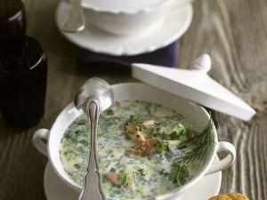 Cremige Suppe mit geräucherter Forelle, Porree, Dill und Kerbel Rezept
