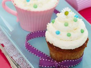 Cupcakes mit Vanille und Gänseblümchen Rezept