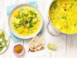 Curry mit Erbsen und Kartoffeln Rezept