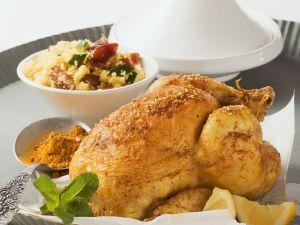 Curryhuhn mit Zucchini-Dattel-Cousous Rezept