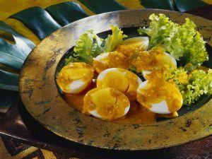 Eier mit Currysauce Rezept