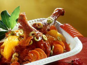 Entenkeulen mit Orangen und Oliven Rezept