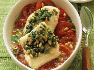 Fischfilet auf Tomaten gebacken Rezept