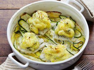 Fischfilets mit Kartoffelhaube auf Zucchinibett Rezept