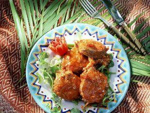 Fischkoteletts in Tomatensauce Rezept