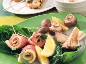 Fondue mit Pilzen und Käse-Schinken-Röllchen im Ausbackteig Rezept