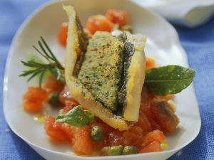 Forelle mit Kräuterkruste auf Tomaten gegart Rezept