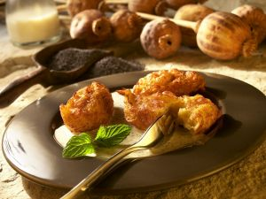 Frittierte Kartoffelklößchen mit Mohnsauce Rezept