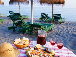 Fruchtige Paella mit Meeresfrüchten Rezept