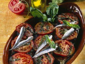 Gebackene Auberginen mit Tomaten und Sardellen Rezept
