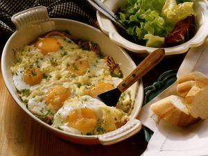 Gebackene Eier mit Schinken und Käse Rezept
