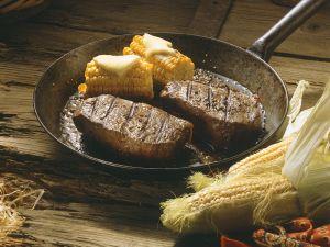 Gebratene Steaks mit Mais Rezept