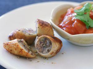 Gefüllte Calamari mit Paprikagemüse süß-sauer Rezept