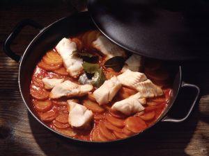 Geschmorte Kartoffeln mit Stockfisch Rezept