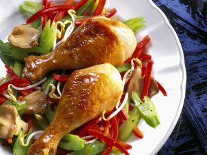 Glasierte Hähnchenkeulen auf Gemüse Rezept