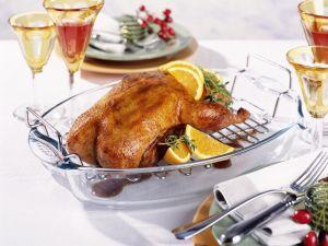 Glasierte Orangen-Ente mit Kräutern Rezept