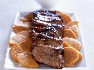 Glasiertes Schweinefleisch mit Süßkartoffeln Rezept