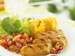 Grillwürstchen mit Salat und Maiskolben Rezept